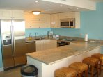 Top-of-the-line full-size fully equipped kitchen with 4-seat bar-table