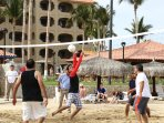 Even join in on a vigorous game of beach volleyball.