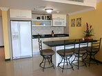 fully equipped modern kitchenette with 4-seat breakfast/bar