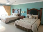 Spacious master bedroom with two queen-size beds!