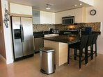Fully equipped modern kitchen with 3-seat breakfast/bar-table