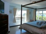 Master bedroom with  TV, ocean and pool view