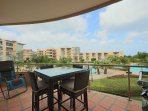 Your balcony with 4-seat dining table, BBQ and lounge chair