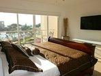 Ocean view and flatscreen HDTV in master bedroom