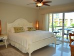 Master bedroom with a romantic king-size bed