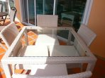 ....4-seat dinning table on balcony.