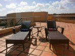 Two lounge chairs on your private roof terrace.