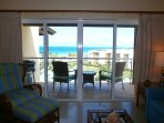 Living area lends access to balcony with beach view!