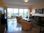 Living room with flatscreen HDTV and ocean view!