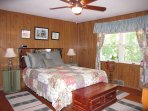 queen waterbed, room has a view of the woods