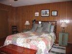 queen size waterbed in  master bedroom