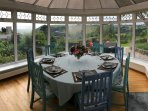 Conservatory. Dining for 8 people with stunning sea & countryside views no matter what the weather.