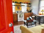 Bright, colorful kitchen, fully equipped for your stay.