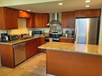 The fully equipped kitchen has been completely updated with granite countertops and stainless steel appliances.