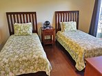 The second bedroom is appointed 2 twin-sized beds.