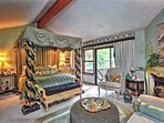 Romantic master with fireplace and seating area. Access to deck.