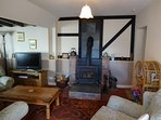 Large open plan living area, plenty of seating, log fire, flat screen t.v. dvd & films, books