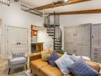Queen size Murphy bed is located behind the sofa, spiral staircase (note the height & slope at the top) lead to the...