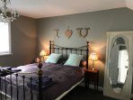 The main bedroom has tons of storage, antique pieces and Egyptian cotton sheets.