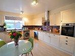 Spacious and stylish kitchen with dishwasher and washing machine