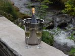 Champagne by the river at the front of the cottage