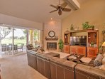 Step through the sliding glass door in the living room outside to the patio.
