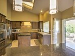 The fully equipped kitchen boasts granite counters and stainless steel appliances.