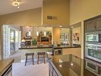 There's a breakfast bar in the kitchen with seating for 4 guests.