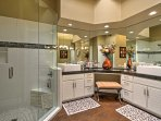You'll find a walk-in glass shower, hardwood floors and a massive vanity in the master bathroom.
