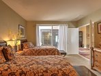 The third bedroom has private access to the outdoor courtyard through the sliding glass door.