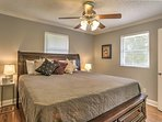 Two guests will sleep well in the master bedroom, which features a king-sized bed.