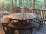 Lower porch with rustic furniture
