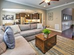 The open concept living area is beautifully decorated and features wood floors throughout.