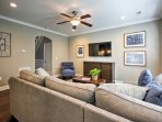 Relax in the living room with a plush sectional couch and flat screen cable TV.