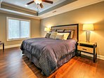 Unwind after a long day in the master bedroom, which features a king-sized bed, flat-screen cable TV, and en suite...