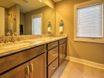 The en suite master bathroom offers stunning granite counter tops, his and hers sink, and a walk-in shower.