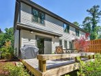 Catch some sun on the rear deck with a gas grill, wraparound bench and an outdoor table and chairs.