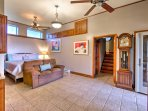 The spacious master bedroom boasts a king bed, kitchenette, large en suite bathroom, and access to the patio with a hot...