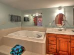 Soak away all of your stresses in the Jacuzzi tub in the master bathroom.