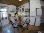 Kitchenette and dinning, includes fridge and washer /dryer