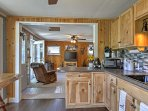 The kitchen is fully equipped with updates and appliances.