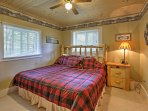 The master bedroom boasts a plush king bed!