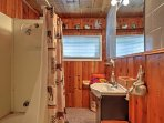 The bathroom offers a stand up shower and single sink vanity.