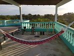 Relax in the hammock as you enjoy the breathtaking view of the Caribbean Sea and surrounding areas
