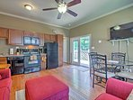 Hardwood floors and stylish furniture fill the main space of the home.