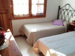 Dormitorio dos camas individuales