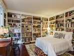 Downstairs king bedroom surrounded by charming books!