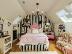 Second floor queen bedroom with fun black and white stripped walls!