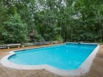 Side view of the pool in this lovely forest setting. A true place for relaxation and enjoyment!