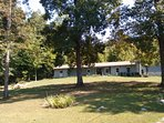 Lovely front yard with lake views and access. Surrounded by 100 acres of woodland.  Very private.